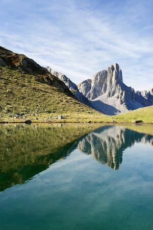 Ansabere Aiguilles reflected in Ansabere Lake. Lescun Cirque. Aspe Valley, Pyrenees, France.