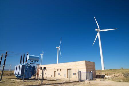 Windmills and electrical substation, Zaragoza province, Aragon, Spain. Foto de archivo