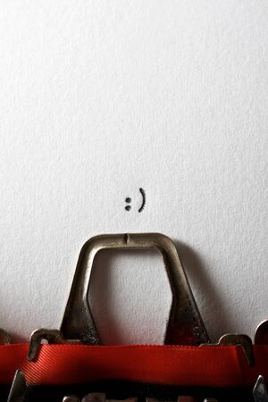 Smile face typewritten in a paper.