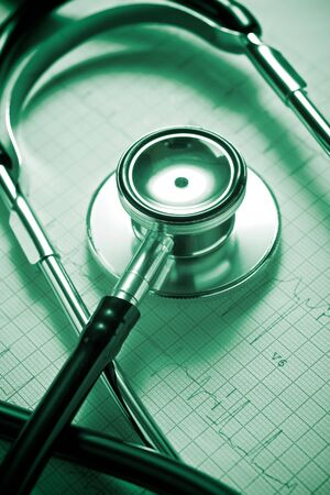 Close up of an electrocardiogram in paper form and a stethoscope.