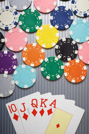 Cards and casino chips on a metal surface. Stock Photo