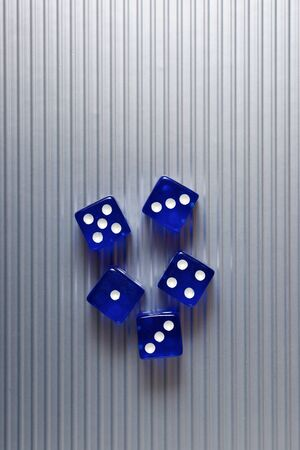 Casino dices on a metal surface. Stock Photo