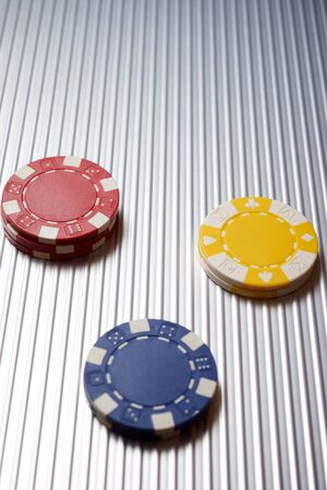 Casino chips on a metal surface, Stock Photo