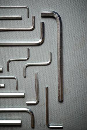 Allen keys on a stone table 版權商用圖片