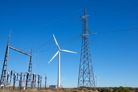 Windmills and electrical substation, Huesca province, Aragon in Spain. Stock Photo
