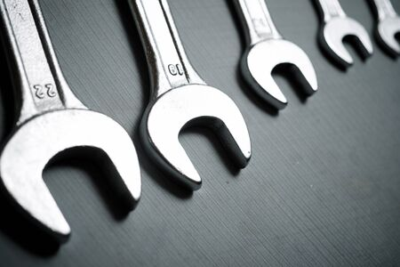 Wrenches on a stone table