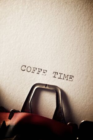 The sentence, Coffee Time, written with a typewriter.