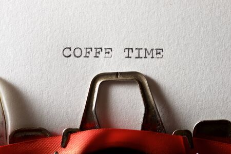 The sentence, Coffee Time, written with a typewriter. Archivio Fotografico - 138044505