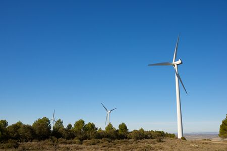 Windmills for electric power production, Huesca province, Aragon in Spain. 스톡 콘텐츠