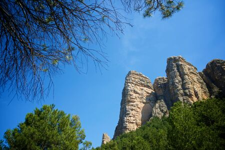 Rock wall, named as Masmut Rocks, in Penarroya de Tastavins, Teruel, Aragon, Spain.