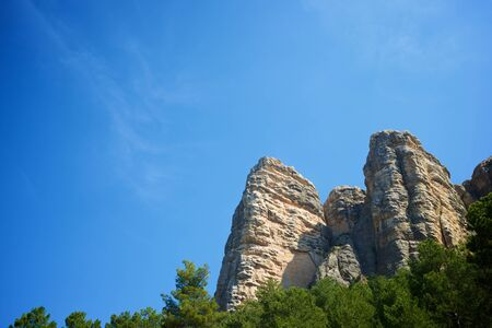 Rock wall, named as Masmut Rocks, in Penarroya de Tastavins, Teruel, Aragon, Spain.