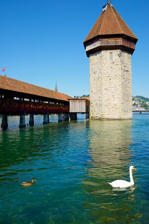 Famous Chapel Bridge view in old town of Lucerne in Switzerland.