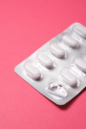 View of a white medicine pills in blister pack.