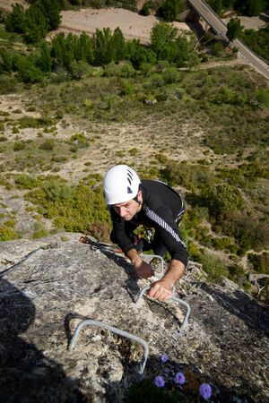 Climbing a Ferrata route in Calcena, Zaragoza Province, Aragon, Spain.