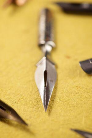 Nib pens for calligraphy on a paper. Foto de archivo