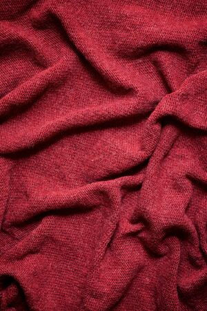 Close up of a garnet colored fabric.