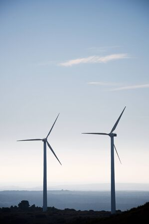 Windmills for electric power production, Huesca province, Aragon in Spain. Stock Photo