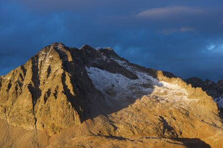 Peaks at sunset, Balaitus Mountains in Tena Valley, Huesca Province, Pyrenees, Aragon in Spain.