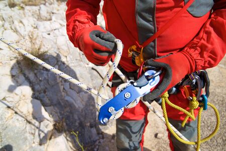Management of a device used to rappel in Caving, Zaragoza Province, Aragon, Spain.