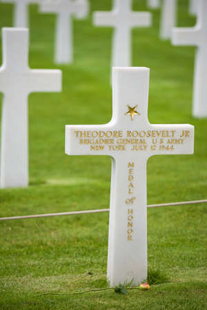 Coleville-sur-Mer, France - August 19, 2014: cross dedicated to Theodore Roosevelt in Omaha Beach, Normandy, France.