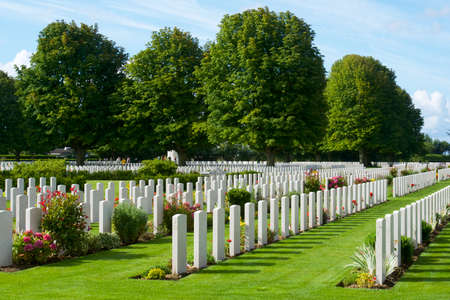Bayeux, France - August 20, 2014: Tourists walking in the British cemetery. 報道画像