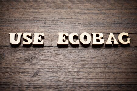 Use ecobag text on a wood table. Imagens