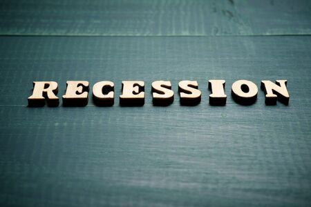 Recession word on a wood table.