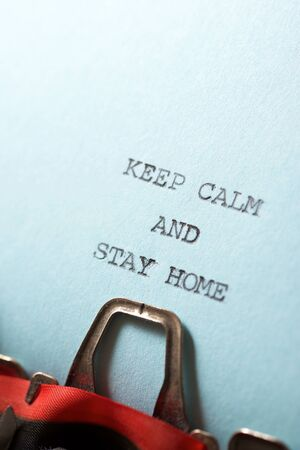 Keep calm and stay home text written on a paper.
