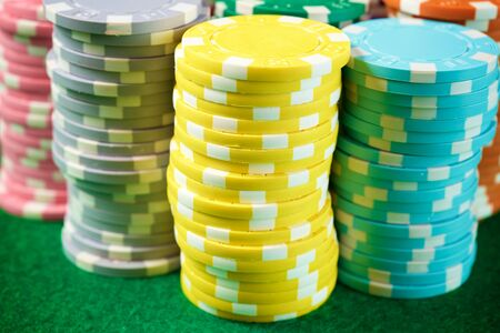 View of a gaming table with green mat and casino chips.