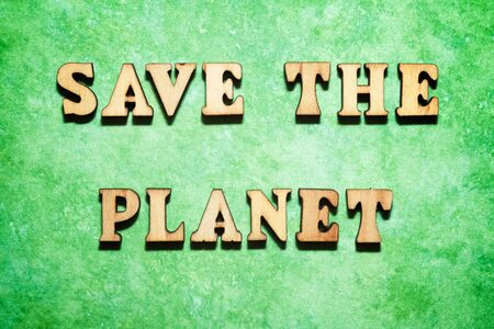 Save the planet text on a green paper.