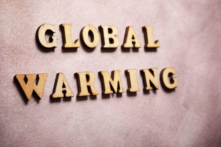 Global warming text on a colored paper.