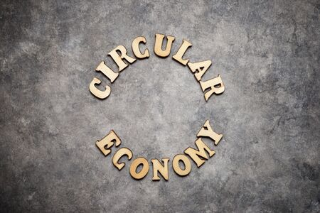 Circular economy text on a gray paper.