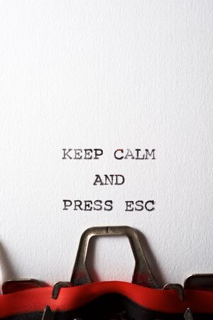 Keep calm and press esc text written with a typewriter.