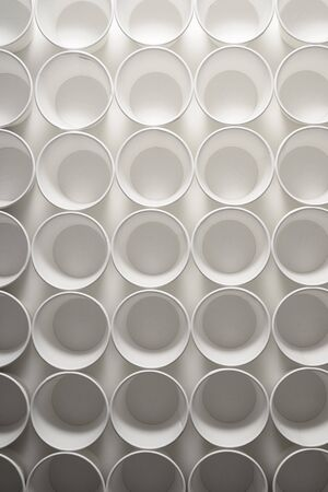 Large group of disposable paper cups.