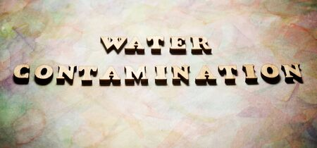 Water Contamination text in a colored paper.