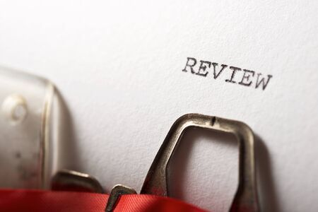 Review word written with a typewriter. Stock Photo