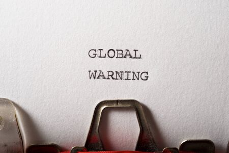 Global warning text written with a typewriter.