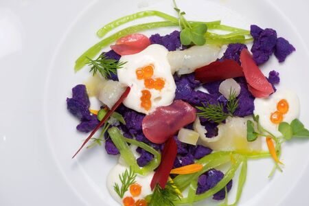 Russian salad on a white plate.