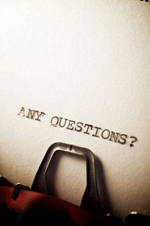 Any questions? text written with a typewriter.