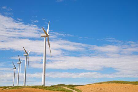 Windmills for electric power production, Zaragoza province, Aragon in Spain. Foto de archivo