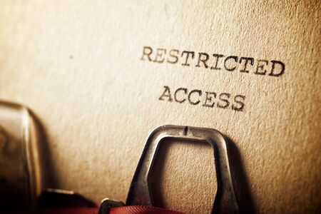 Restricted access text written on a paper.