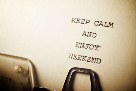 Keep calm and enjoy weekend text written with a typewriter.