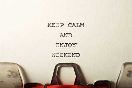 Keep calm and enjoy weekend text written with a typewriter. Archivio Fotografico