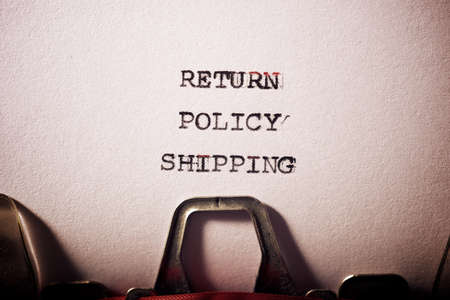 Return policy shipping text written on a paper.