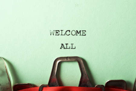 The text, Welcome all, written with a typewriter.