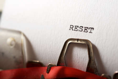 Reset word written with a typewriter. Stock Photo
