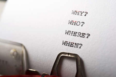 Why, who, where and when questions written with a typewriter.