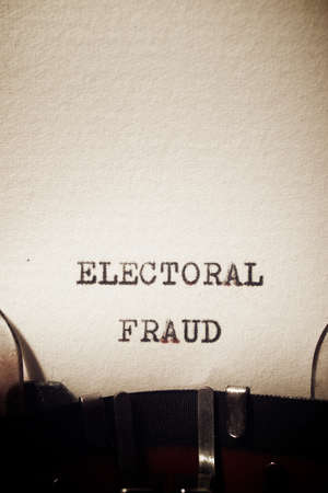 Electoral fraud phrase written with a typewriter.