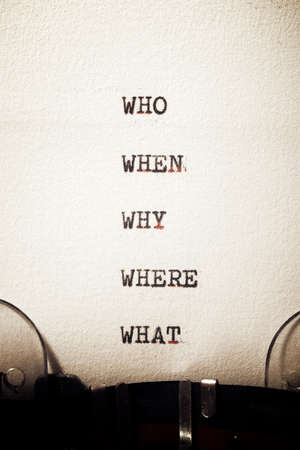 Why, who, where, when and what questions written with a typewriter.
