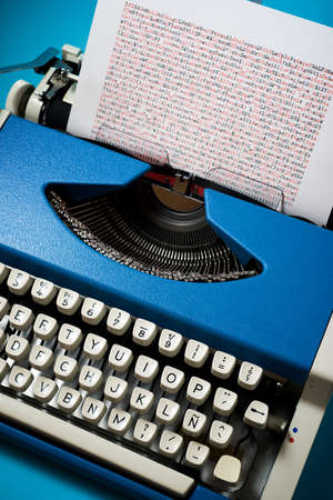 Vintage typewriter on a blue table.